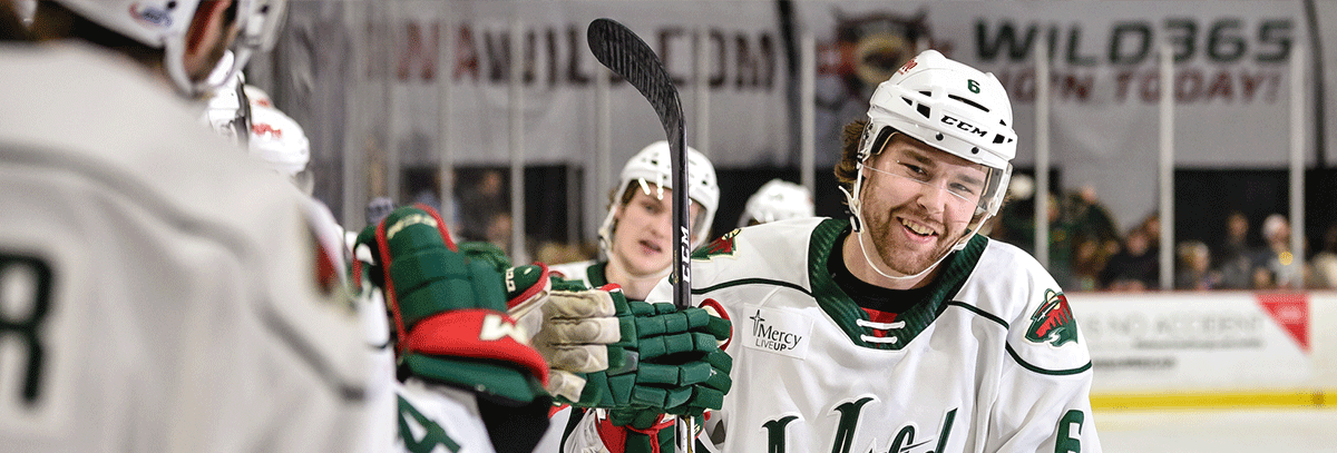 IOWA WILD SIGNS FOUR TO CONTRACTS