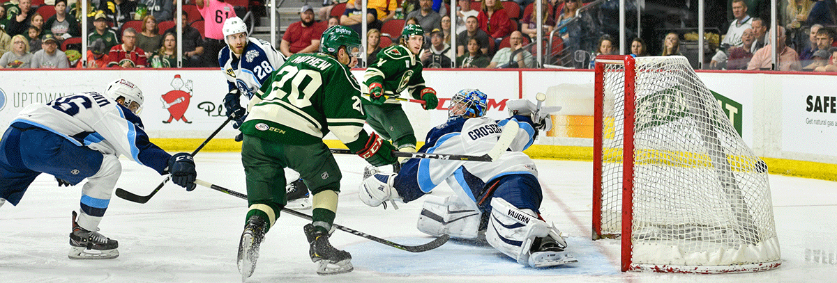 WILD SAVOR FIRST PLAYOFF VICTORY, FOR AT LEAST ONE NIGHT